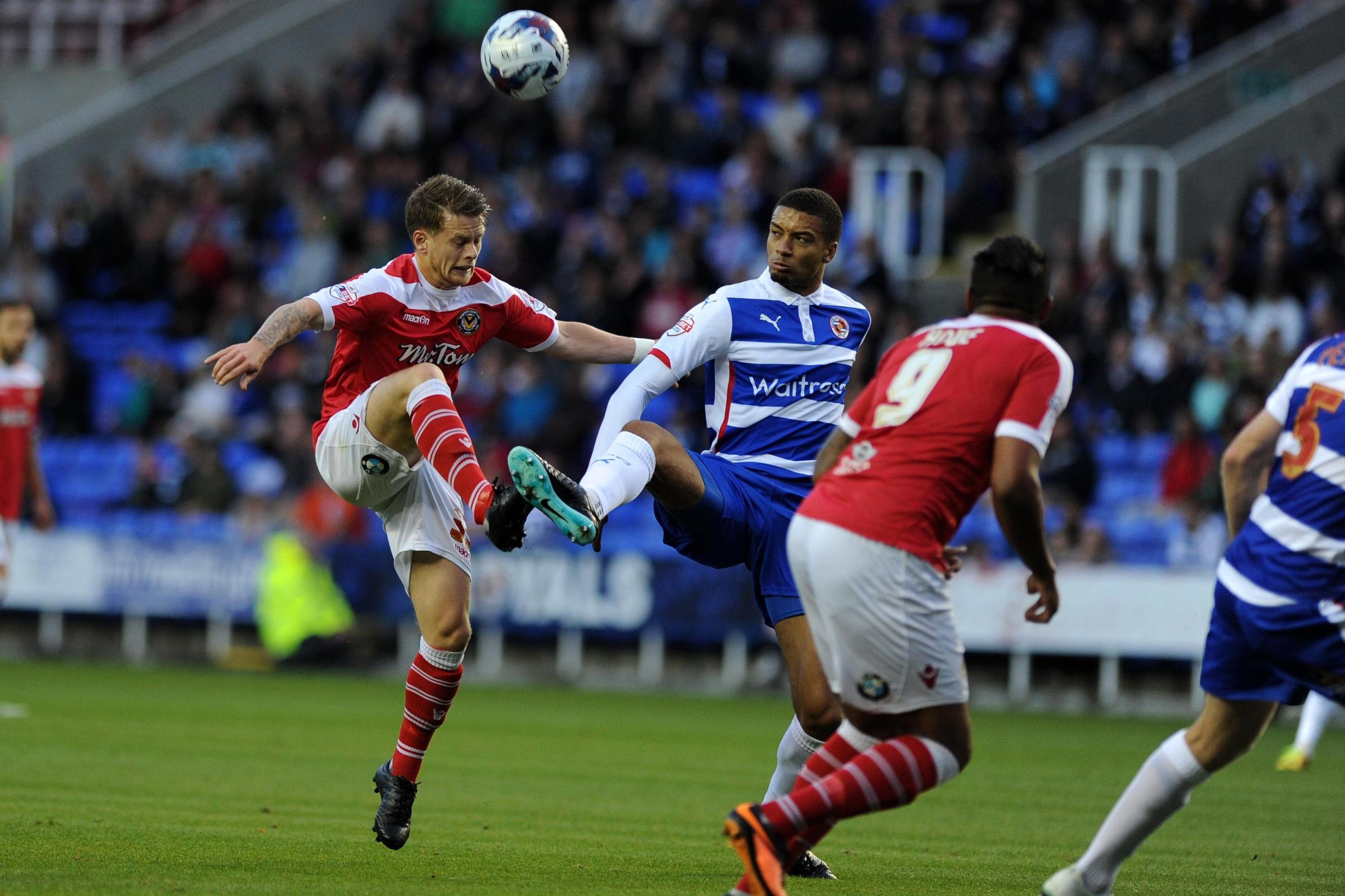 Newport's Mark Byrne is challenged by Reading's Michael Hector.  Capital one cup, round one match, Reading v Newport County at The Madejski Stadium in Reading, Berks on Tuesday 12th August 2014.pic by Andrew Orchard, Andrew Orchard sports photogra