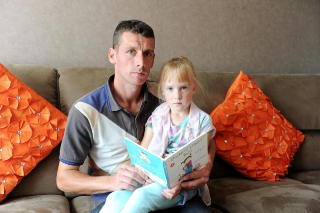 Pictured at their home in Bettws is father Mark Davis with his daughter Maisey aged 4, who is still waiting for a school before term starts in September. (9207344)