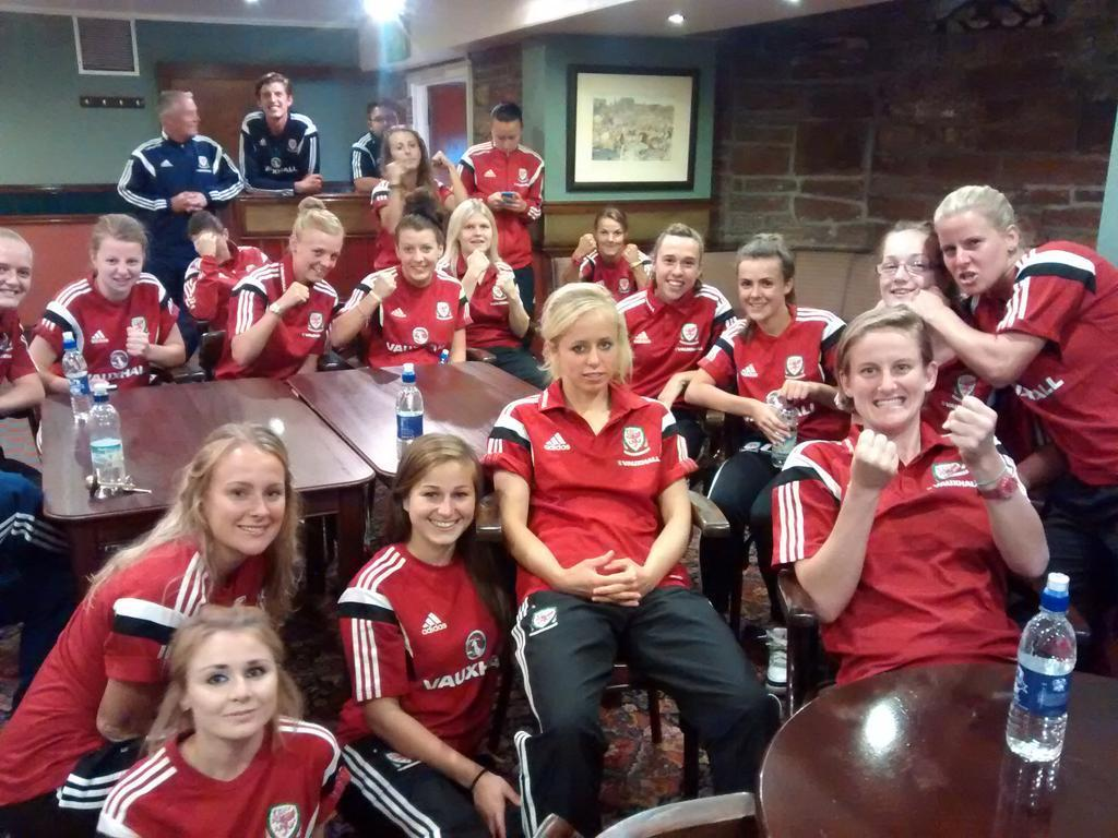 FIGHT CLUB: The Wales women's football team cheer on Lauren Price at Glasgow 2014
