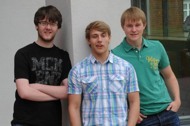 (L-R) Sean Davies from Newbridge 3A*, Ben Hartwell from Six Bells 2A* A and B  and Jack Mainwaring 5A* celebrate their results at Coleg Gwent Cross Keys (9293591)