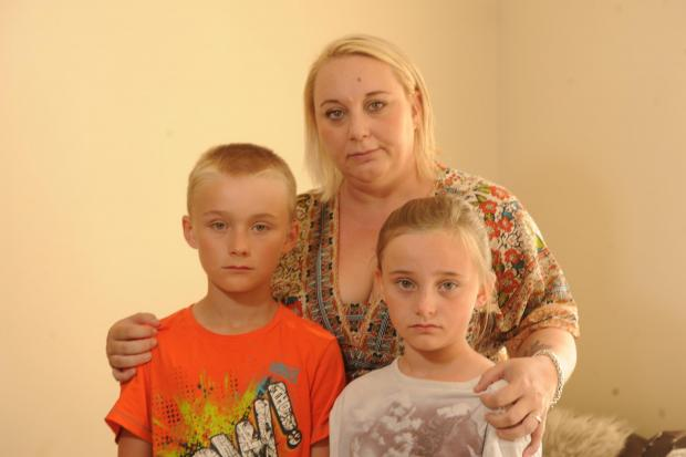 MUm Clare Hallett with her children Joshua and Neeve Hallett who were robbed at knifepoint outside Newbridge Leisure C