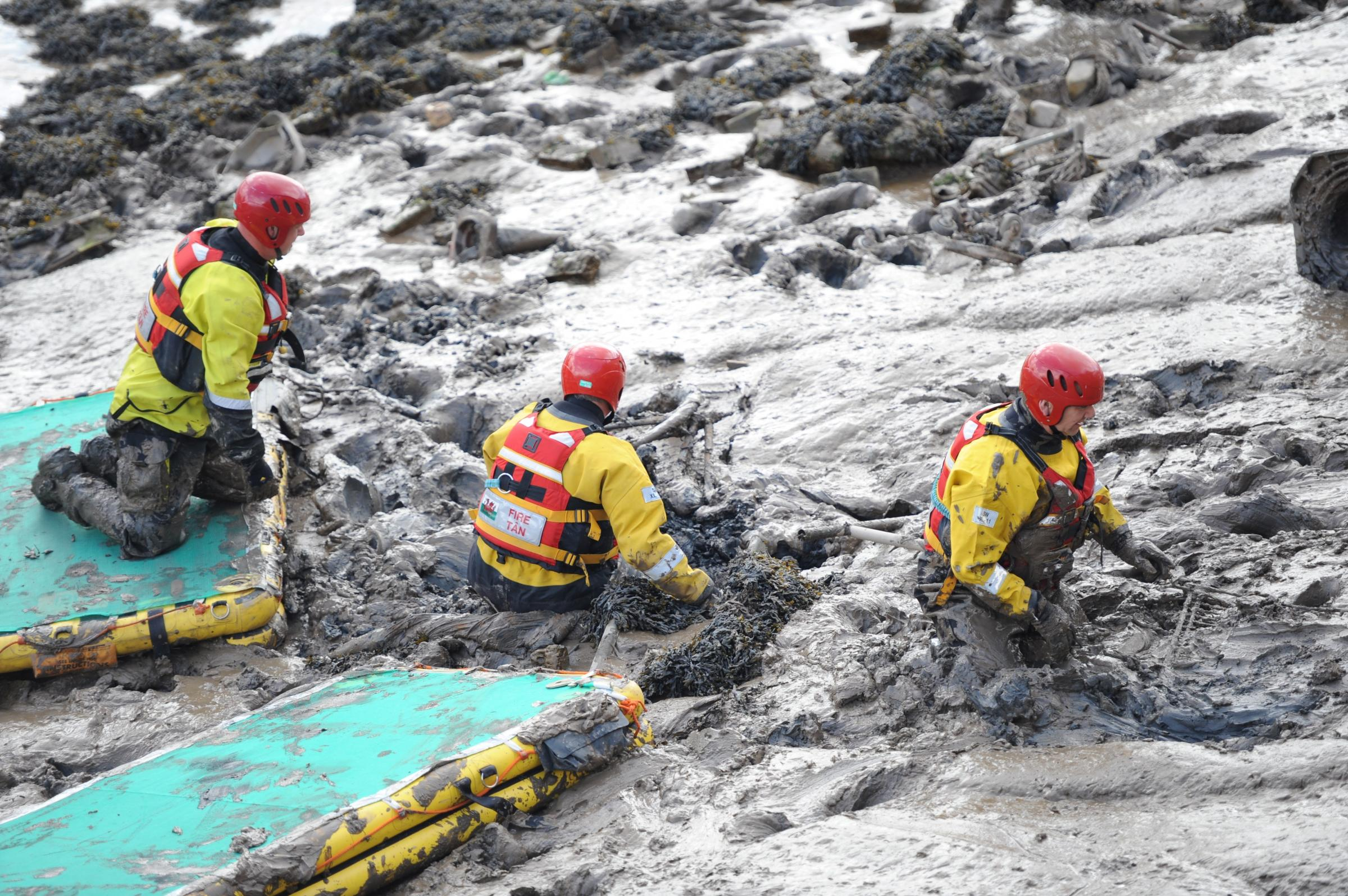 Firefighters clean up at River Usk
