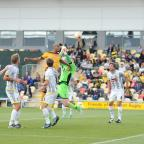 South Wales Argus: Newport County v Burton Albion at Rodney Parade.  Pictured is Newport County player Chris Zebroski winning the header and scoring the opening goal of the first half. (9616537)