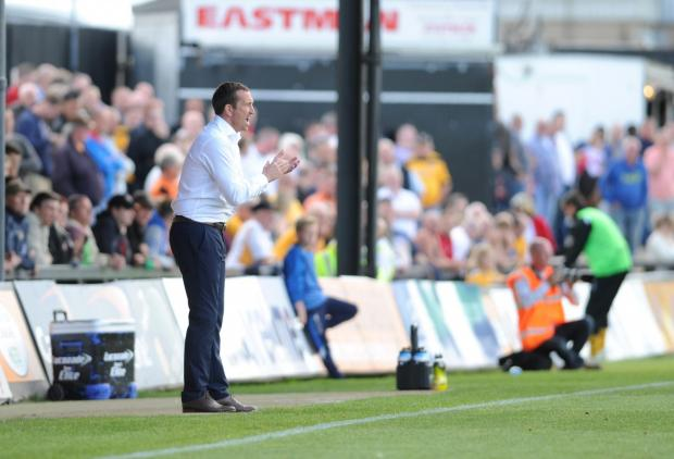 HAPPY: Justin Edinburgh saw his side earn a first point of the season against Burton Albion