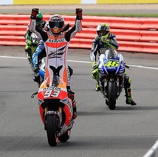 Marc Marquez celebrates winning at Silverstone