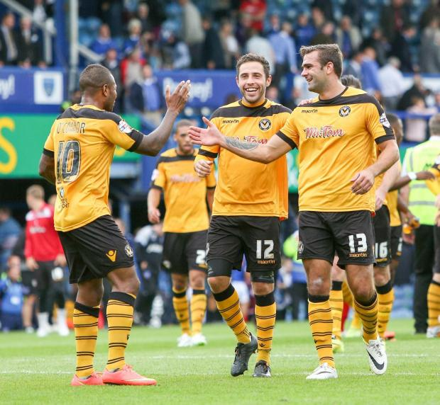 Newport County's Aaron O'Connor & Robbie Willmott congratulate Andy Sandell on a well deserved win. (9869228)