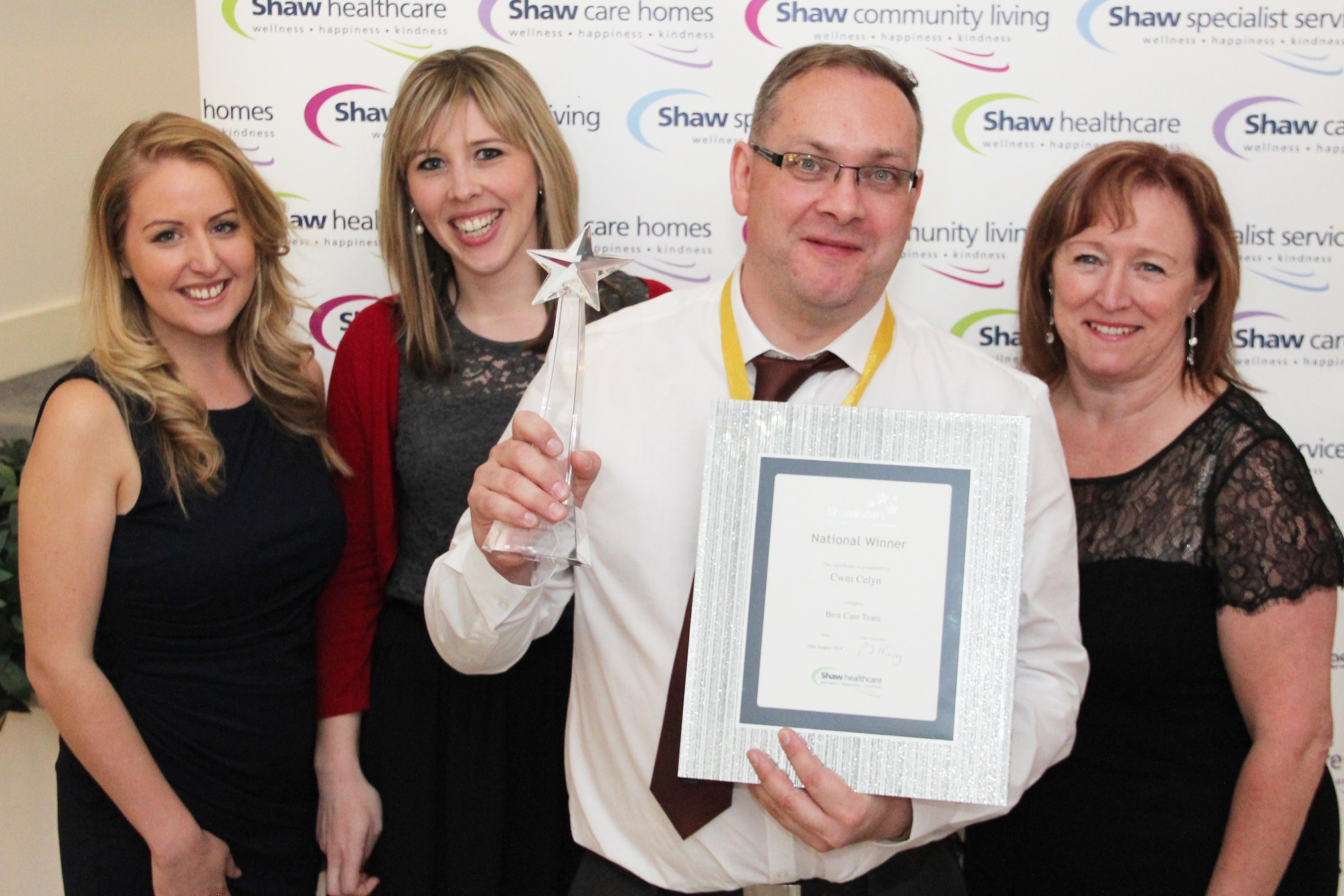 (L-R) Rhian Rogers and Annabel John from award sponsor Freshwater, Simon Morgan, manager of Cwmcelyn and Suzanne Hughes, director of care and operations at Shaw healthcare