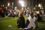 Yes campaign supporters in George Square, Glasgow, as ballet papers for the Scottish independence referendum are counted through the night. PRESS ASSOCIATION Photo. Picture date: Friday September 19, 2014. See PA story REFERENDUM Main. Photo credit should