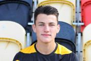 Regan Poole celebrates win with Wales under-17s