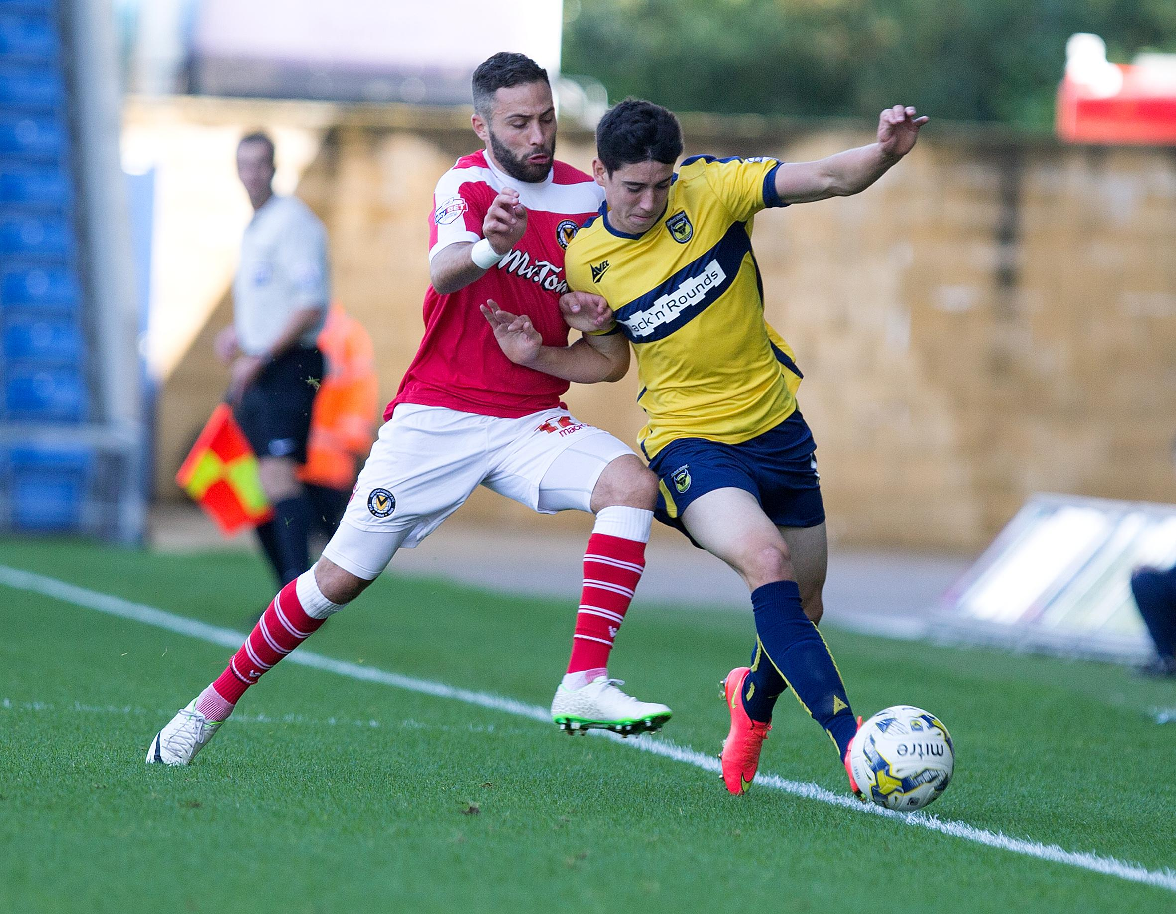 CHALLENGE: County's Robbie Willmott in action against Oxford United. Picture: Damian Halliwell, Oxford Mail