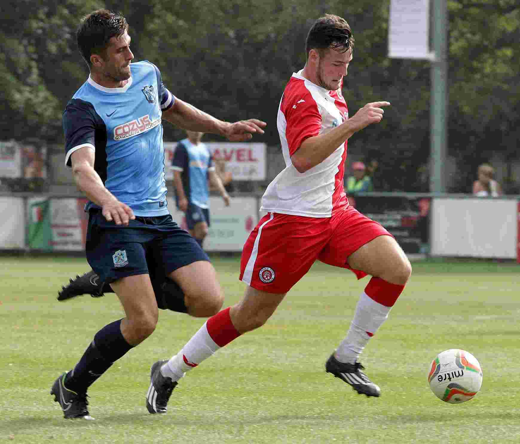 NEW ARRIVAL: Josh O'Hanlon, right, in action for Poole Town