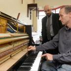 South Wales Argus: Work Experience - John Phillips at Paul's Pianos. Paul Stevens shows John how to tune a Piano. (11014285)