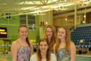 Former Olympic champion Becky Adlington with Newpport swimmers (L-R) Sioned Collingbourne, Anya Thomas and Emme Thomas at Newport Pool (12704626)