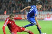 Chris Gunter isbrought down by Anel Hadzic (11357790)