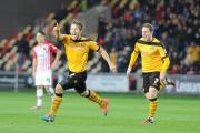 JOY: Max Porter celebrates his equaliser against Exeter City on Sunday with Adam Chapman, right