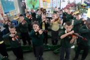 School of the Week - Alway Primary. Year 3 music pupils having a violin lesson. (12730498)