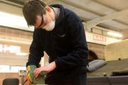 Cieran Kelly Work Experience at Wastesavers Reuse Centre. Pictured is Ciaran sanding a table. (12644284)