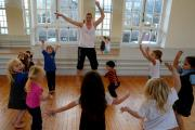 PUT THROUGH THEIR PACES: Dance tutor Emily Pritchard warms up the children (13077167)