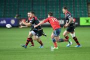 SAME OLD SINKING FEELING: Dorian Jones spreads the ball wide in the Dragons' deflating loss to Munster