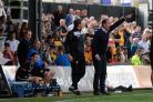 ONWARDS AND UPWARDS: County manager Justin Edinburgh gets his point across