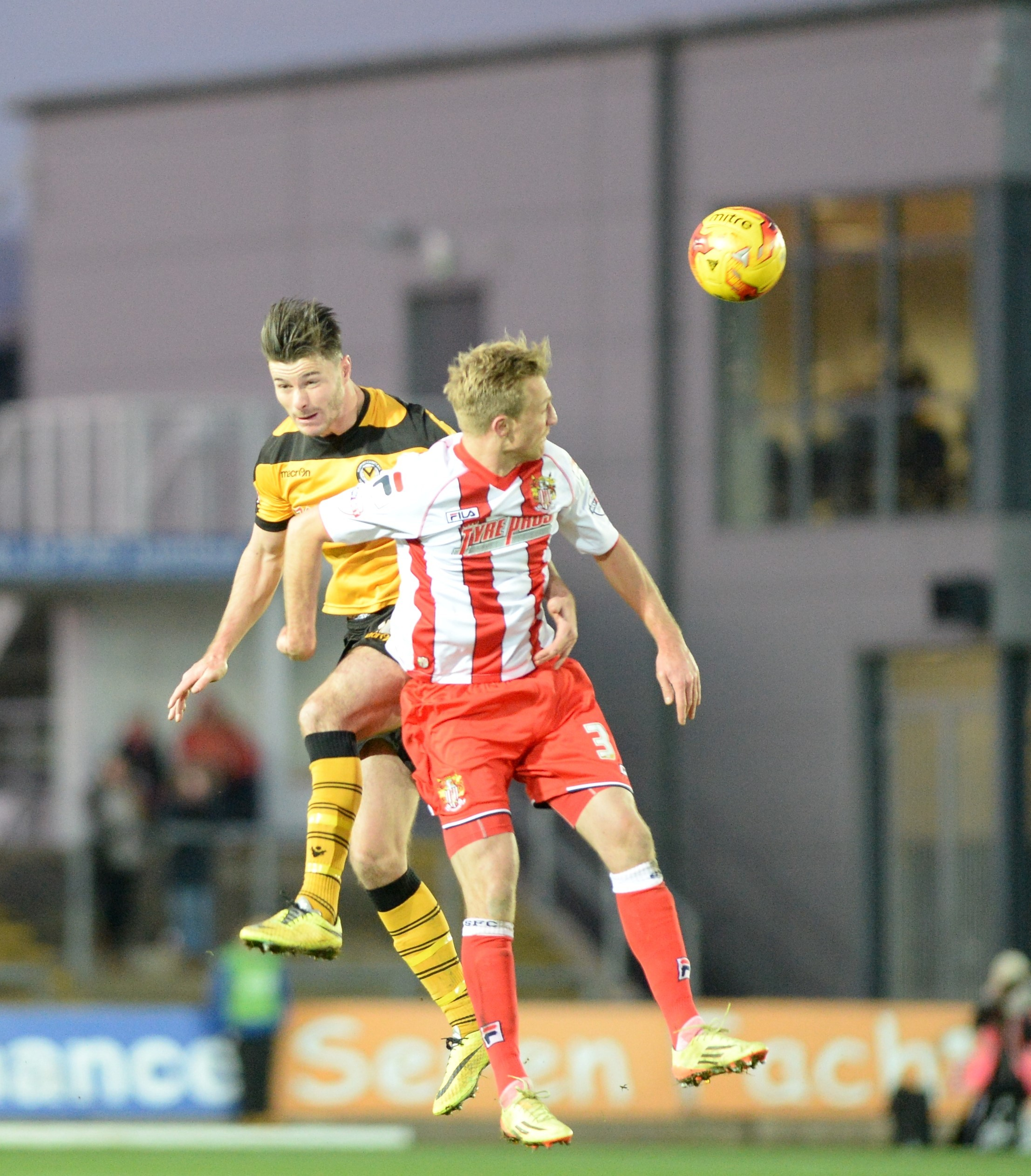 INJURY SCARE: Andrew Hughes wins a header against Stevenage on Saturday