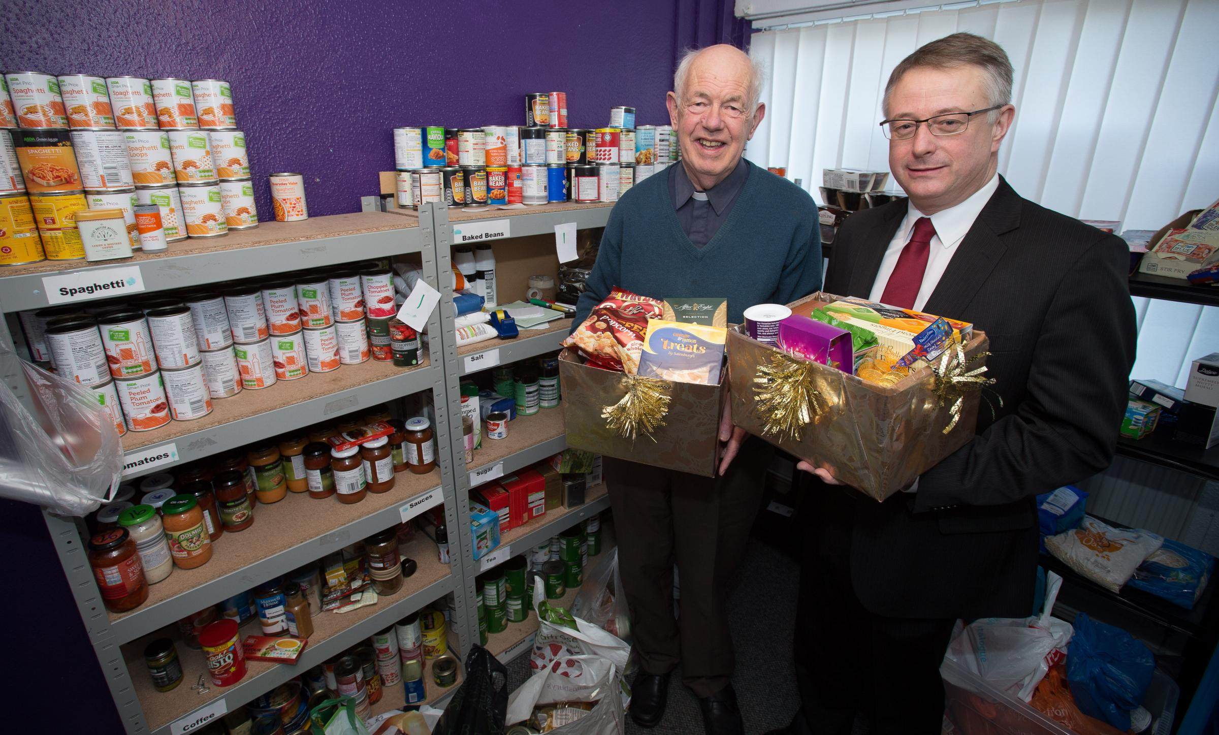 FESTIVE DONATIONS: Canon Henry Davies with David Watts.