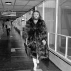 South Wales Argus: Greek singer Demis Roussos leaves London's Heathrow Airport for a tour of Scandinavia in 1974