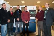 Paul Roberts, of  Torfaen Council (far right), Steve Edwards, MD, (second right) with the rest of the Flamguard team