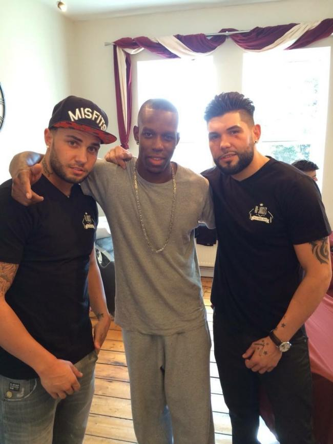 STAR QUALITY: Daniel, left, with a twin from So Solid Crew and Jac at the barber shop