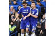 Nemanja Matic, left, is held back by team-mate John Terry as tempers flare after a foul by Burnley's Ashley Barnes