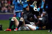 England's Mike Brown receives treatment for an injury during the 6 Nations match at Twickenham, London. PRESS ASSOCIATION Photo. Picture date: Saturday February 14, 2015. See PA story RUGBYU England. Photo credit should read: David Davies/PA Wire