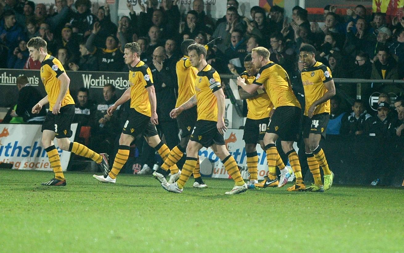 GOAL: County players celebrate Aaron O'Connor's winner against Luton