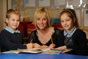 Teacher Robyn Wilford helps pupils William Mumford aged 7 and Darcie Williams aged 7 with their school work (21205580)