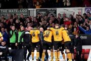 Newport County v Hartlepool United County celebrate with manager Jimmy Dack after Aaron O'Connor scores their 2nd (22408535)