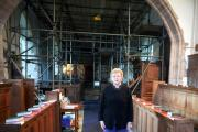 St Cybi's Church in Llangybi has launched a major appeal to raise a £100 000 for repairs to the roof etcASSISTANT CURATE Reverend Pamela Love infront of the scaffolding (15590855)