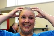Sarah Carmock  from Cwmbran shaved off her hair to raise funds for two charities,  (24293593)