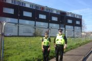 Sergeant Sarah Davies and Inspector Kevin Warren outside the problem flats