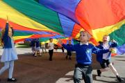 COLOURFUL: Reception and Year One pupils enjoying 'parachute play' - Pictures by Michael Eden