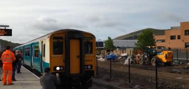 FIRST ARRIVAL: EBBW Vale residents welcomed the first train which pulled into the new Town Station this morning.