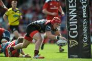 TRY TIME: Centre Tyler Morgan crosses for the second of the Dragons' four tries in Munster