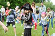 Amelie Margetts, 7, gets pelted with wet sponges while walking the plank at Pirate day at Tredegar House.