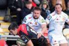 HARD GRAFT: Exeter prop Tomas Francis, pictured tackling Newport Gwent Dragons' Nick Crosswell, is set for his Wales debut
