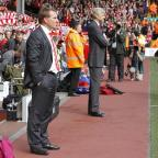 South Wales Argus: Brendan Rodgers, who has been sacked by Liverpool, stands with Arsenal manager Arsene Wenger during a league match at Anfield last year