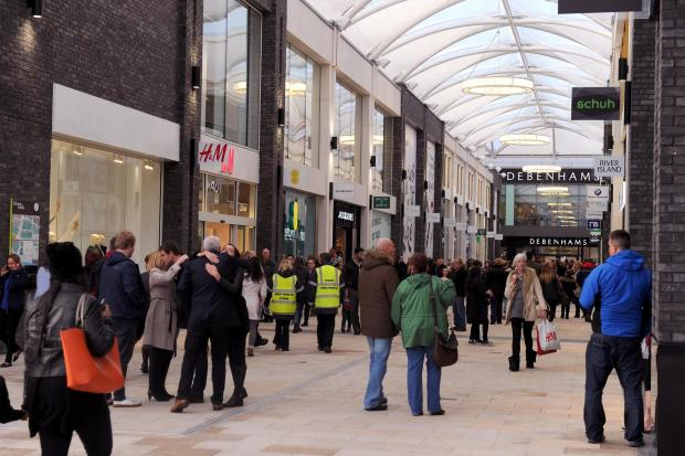 South Wales Argus: Shoppers inside Friars Walk - though many of the retailers pictured have since departed