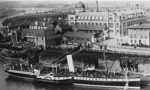 South Wales Argus: BUSTLING: One of the White Funnel steamers gets ready to sail from Davis Wharf. Newport Art College can be seen in the backgound. Pic courtesy of Jan Preece. (49160479)