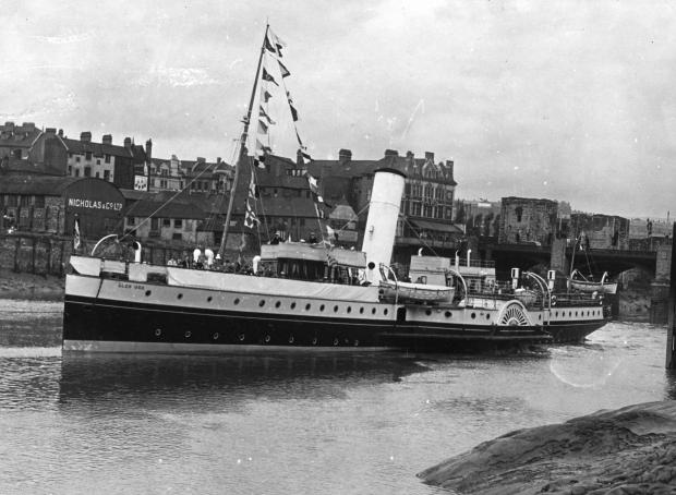 South Wales Argus: SHIPPING CENTRE: The Glen Usk setting off from Davis Wharf in Newport with the twon bridge and castle in the background (49160484)