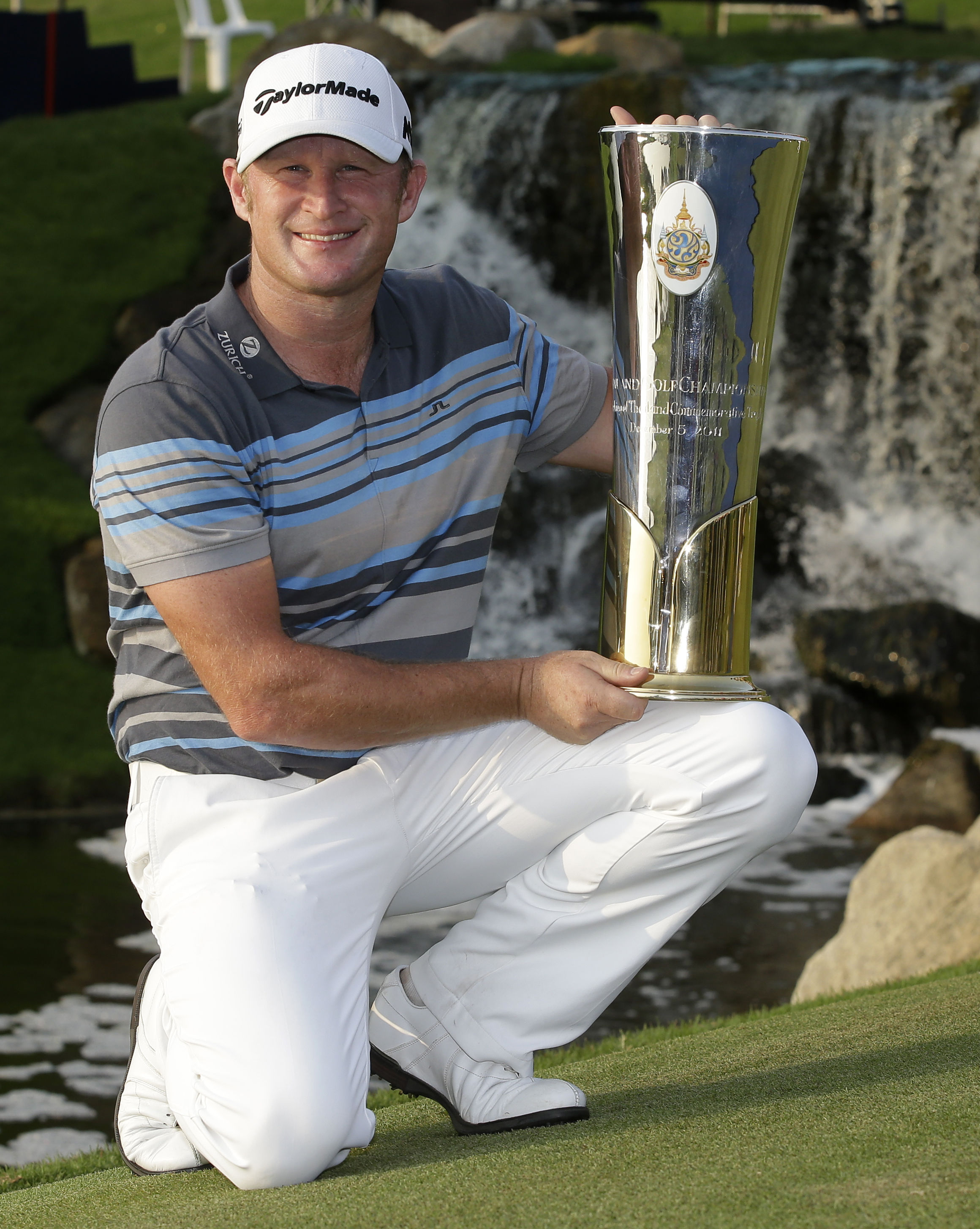 WINNER: Jamie Donaldson of Wales holds his trophy after winning the Thailand Golf Championship
