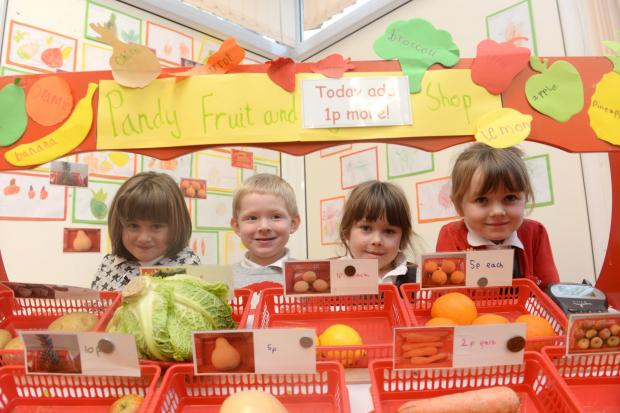 School of the Week - Llanvihangel Crucorney Primary. Jess Whistance, Henry Davies, Ella Driscoll, and Emmee Davies at their fruit and veg stall..