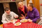 SHELTER: Guest Darren Wood sits down to his evening meal with volunteer Janet Lewis and Mark Hepton Night Shelter co-ordinator