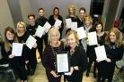 Hair Council political director Shirley Davis-Fox, MBE, presents a state registration certificate to Donna Friend watched by qualified hairdressers at Spirit Hair Team (55214052)